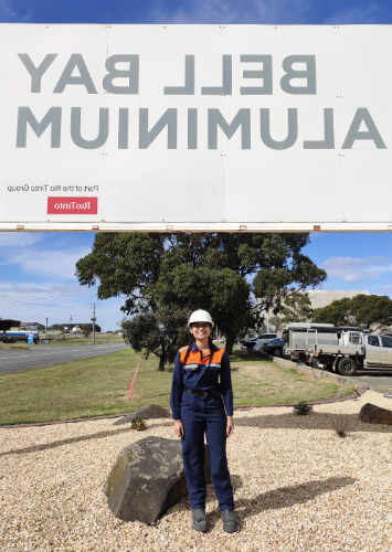 Kamya in front of the Bell Bay Aluminium sign